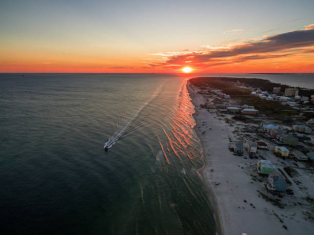 aerial/drone photo of a beautiful sunset over gulf shores alabama - alabama 뉴스 사진 이미지