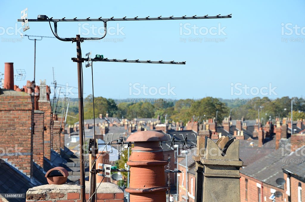 TV Aerials and Chimneys in Typically English Urban Scene stock photo