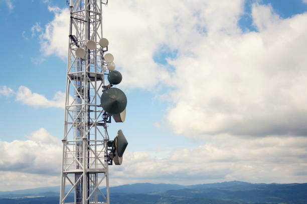 aerials and telecommunication transmitters, digital communication and encryption safety concept - ripetitore per telefoni cellulari foto e immagini stock