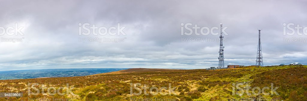 Aerials, transmitters and dishes on landscape royalty-free stock photo