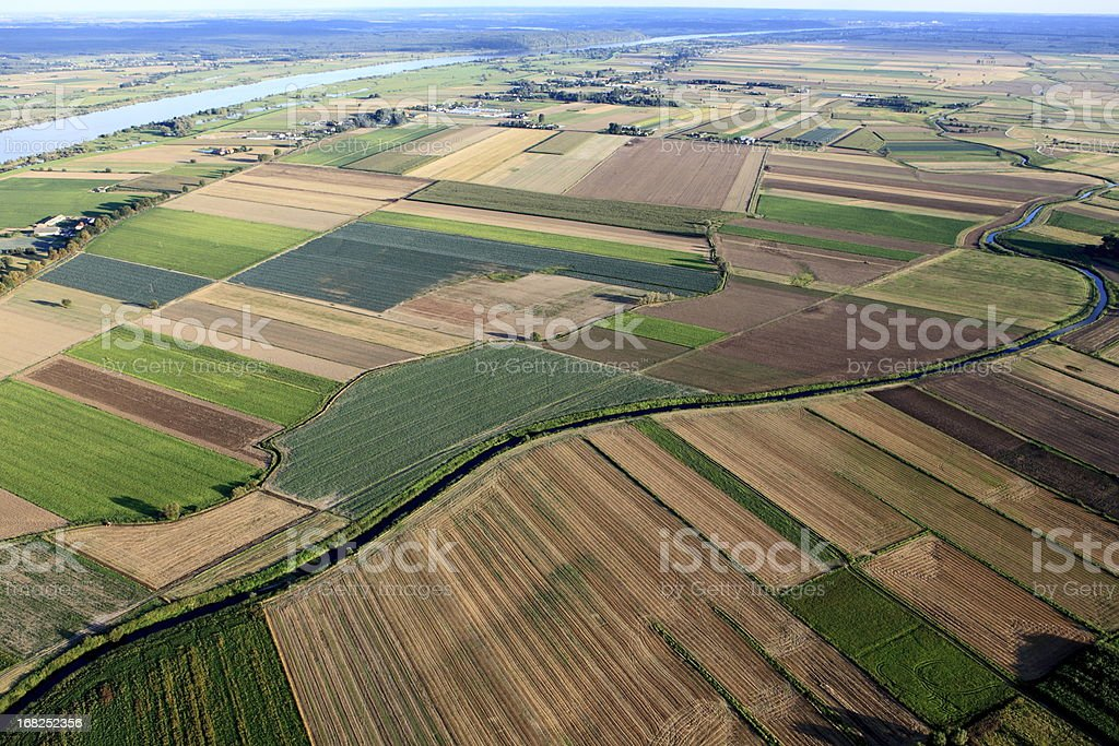 Aero view of massive farmland with various types of plants stock photo
