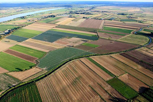 Aero view of massive farmland with various types of plants stock photo