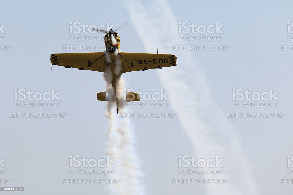 Aerobatic aircraft performs acrobatics royalty-free stock photo