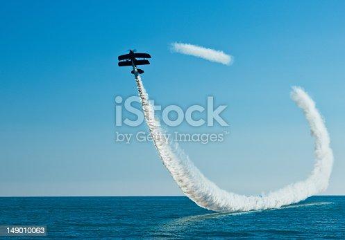 istock Aerobatic biplane on the sky 149010063