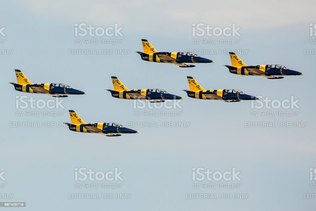 Aerobatic group formation \'Baltic Bees\' at blue sky during...