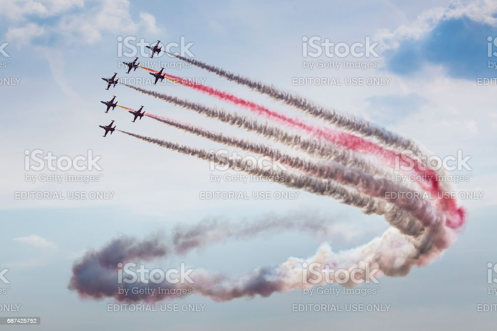 POZNAN, POLAND - JUNE 14: Aerobatic group formation 'Turkish Stars' at blue sky during Aerofestival 2015 event on June 14, 2015 in Poznan, Poland stock photo