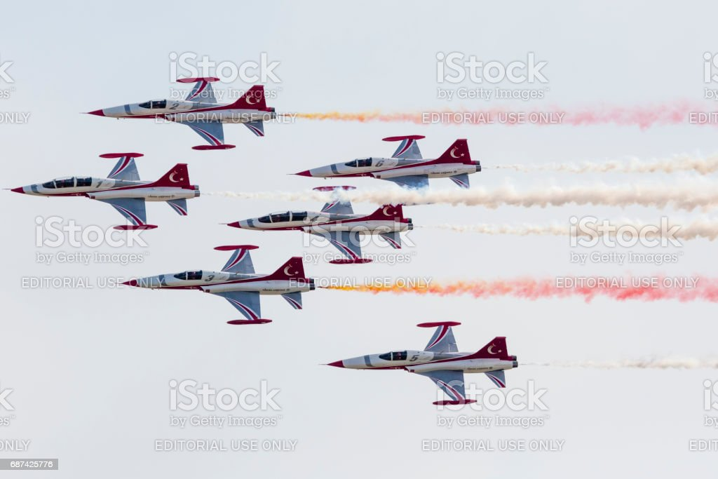 Aerobatic group formation \'Turkish Stars\' at blue sky during...