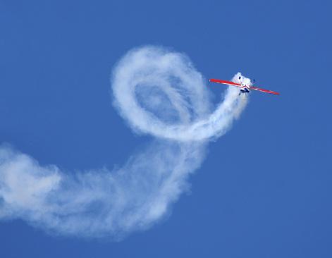 Aerobatic stunt in Extra 300 stunt plane.