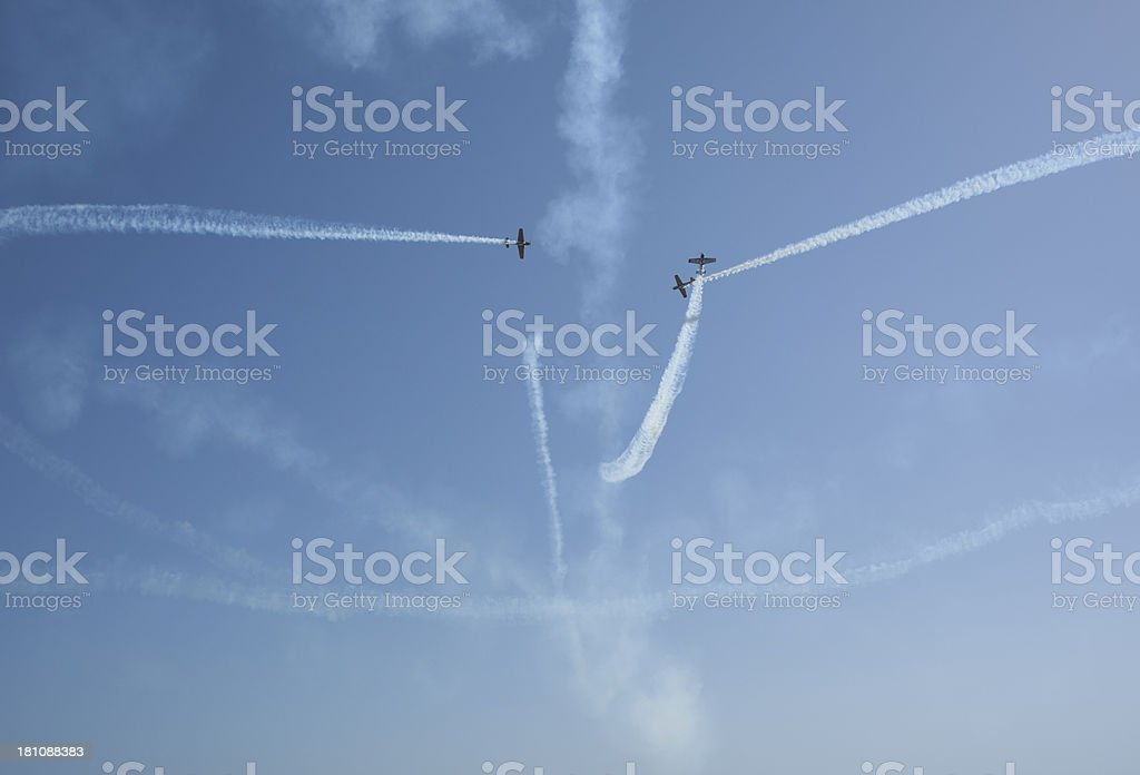 Aerobatic stunt show on the sky by three airplanes royalty-free stock photo