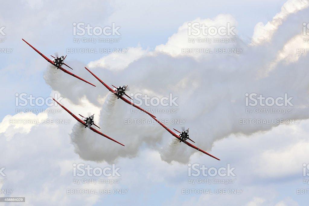 Aerobatic team performs during Oshkosh AirVenture 2013 royalty-free stock photo