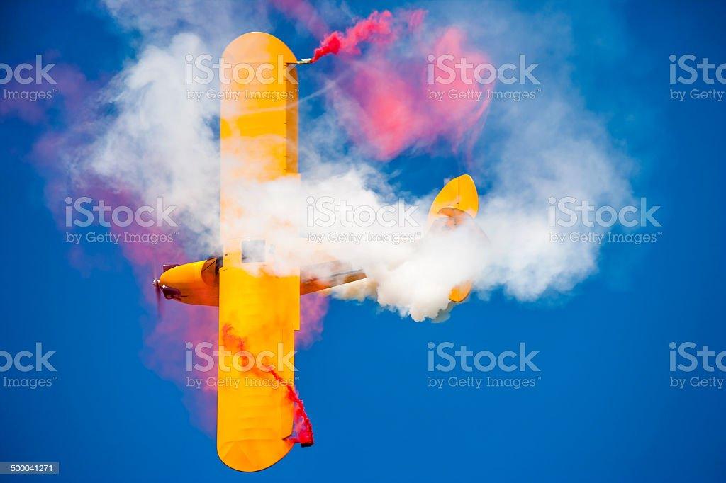 Aerobatic Yellow Aircraft Smoke stock photo