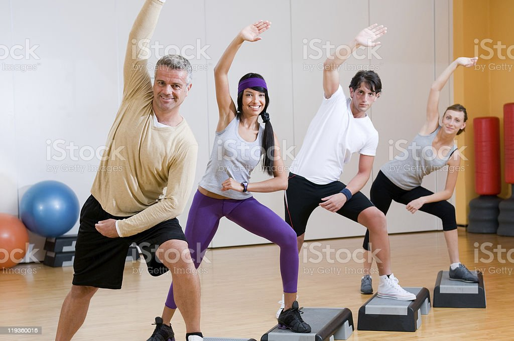 Aerobic exercises at gym stock photo