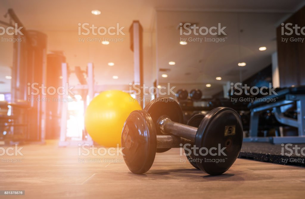 Aerobic Fitball and Dummbell on the floor in the morning. stock photo