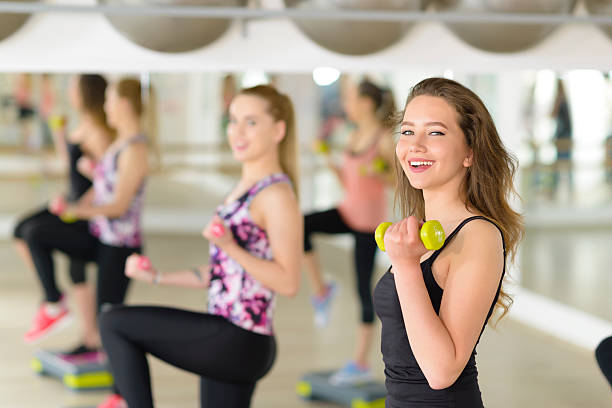 aerobics at gym - aerobics stock photos and pictures