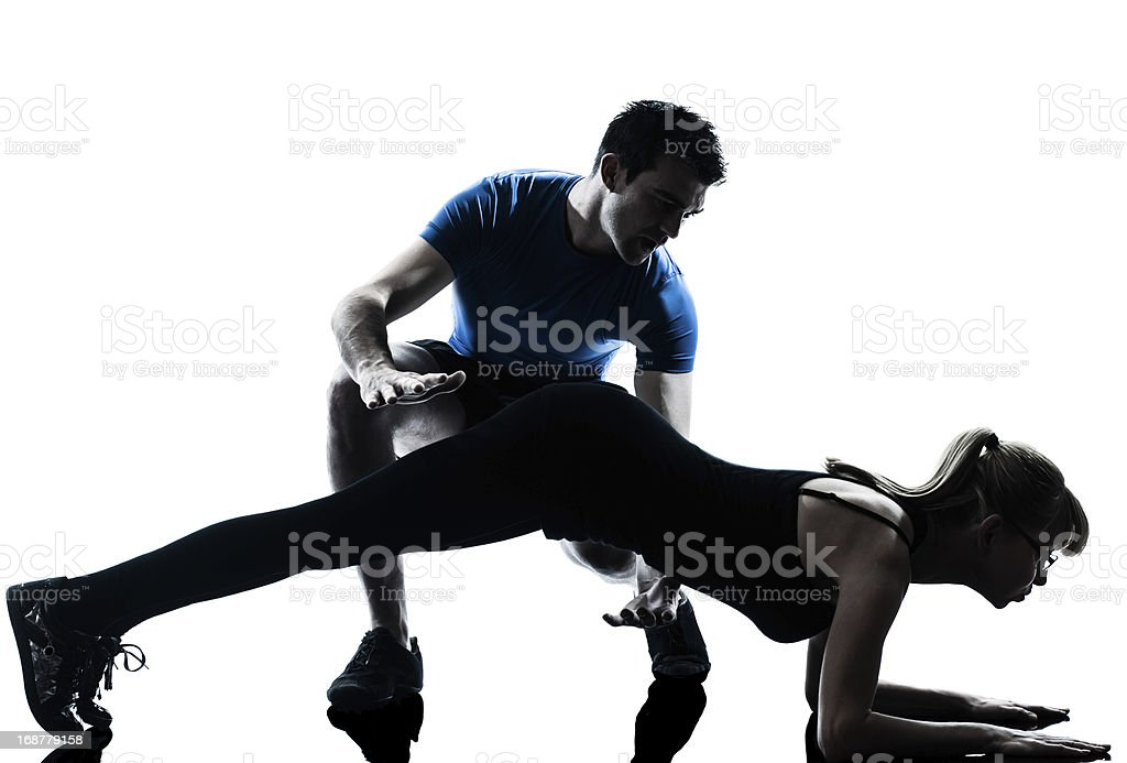 aerobics intstructor with mature woman exercising royalty-free stock photo