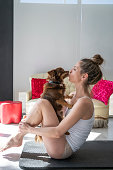 istock Aerobics yoga woman kissing her pet dog 1174974141