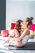 istock Aerobics yoga woman kissing her pet dog 1175651754