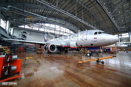 istock Aeroflot Airbus A320 VP-BWD standing in a maintainence hangar at Sheremetyevo international airport. 693119144