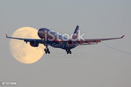 istock SHEREMETYEVO, MOSCOW REGION, RUSSIA - NOVEMBER 29, 2013: Aeroflot Airbus A330 VQ-BBF crossing the moon before landing at Sheremetyevo international airport. 671074946