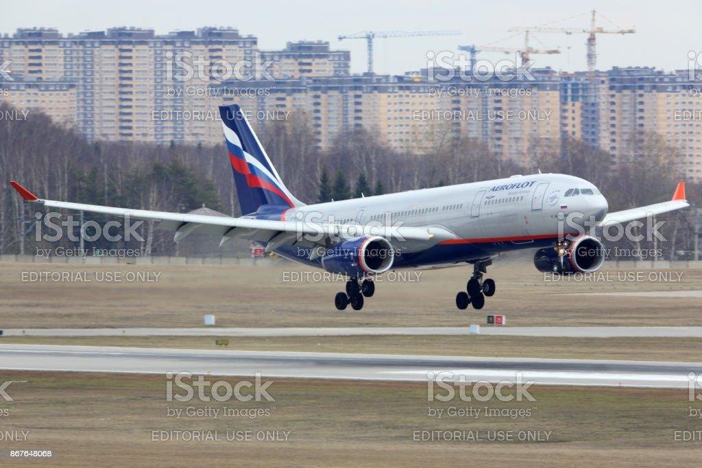Aeroflot Airbus A330-200 landing at Sheremetyevo international airport. stock photo