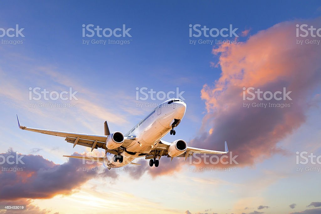 Aeroplane Coming in to Land at Sunset stock photo