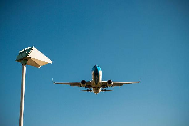 Aeroplane landing stock photo
