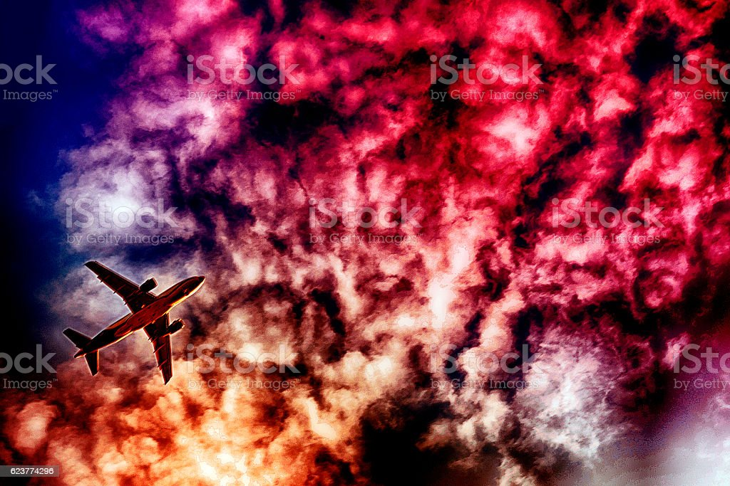 Aeroplane on the cloudy sky, with photographic effects