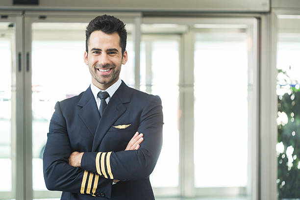 Aeroplane pilot looking at camera and smiling. stock photo