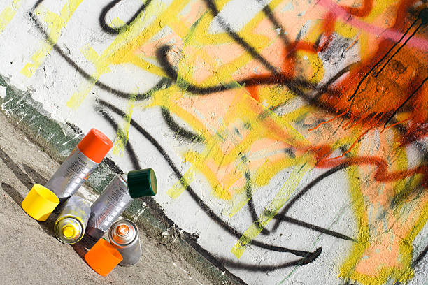 Aerosol paint and graffiti painted wall stock photo