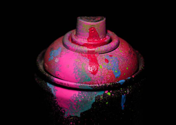 Aerosol paint on a dark background, pink color, dramatic lighting. – Foto