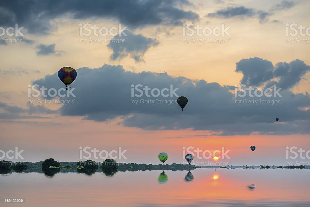 Aerostat in the sky above summer fields. royalty-free stock photo