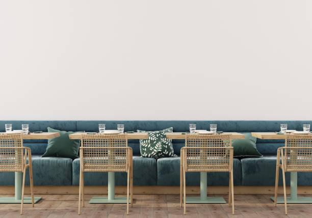 Сafe interior with soft blue sofa stock photo