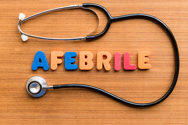 afebrile afebrile colorful word on the wooden background afebrile stock pictures, royalty-free photos & images