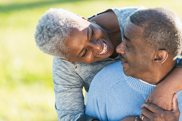affectionate african american couple outdoors - 60 69 years stock photos and pictures