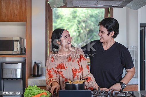 Affectionate androgynous female stroking her wife hair