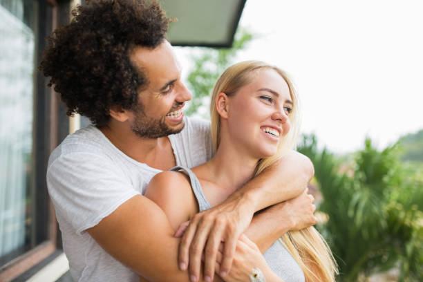 Affectionate couple enjoying fresh air and hugging stock photo