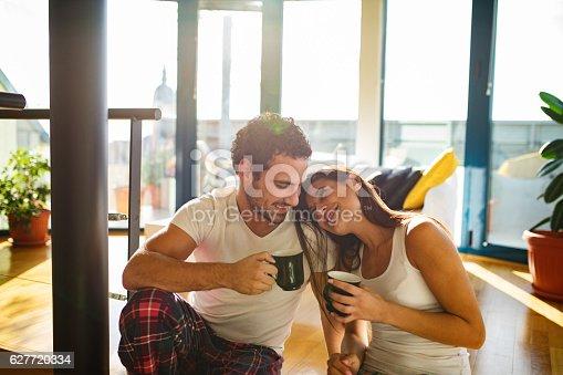 istock Affectionate couple enjoying  morning coffee and flirting 627720334