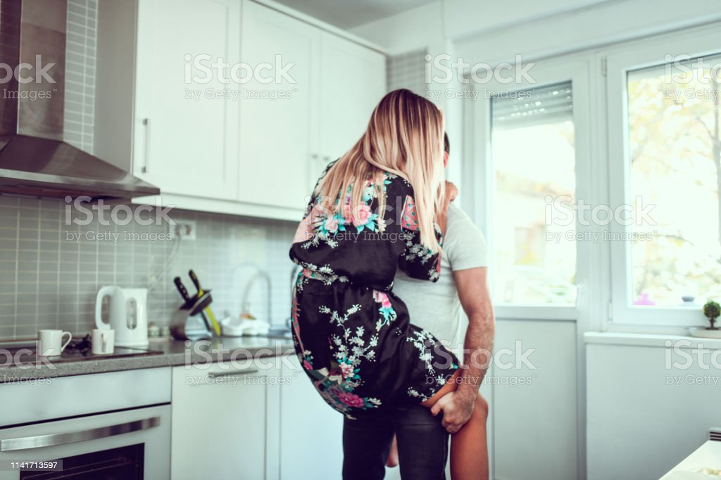 Affectionate Couple Exchanging Romantic Activities In The Morning