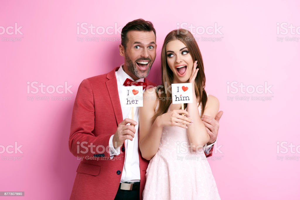 Affectionate couple having a fun while a photo session stock photo