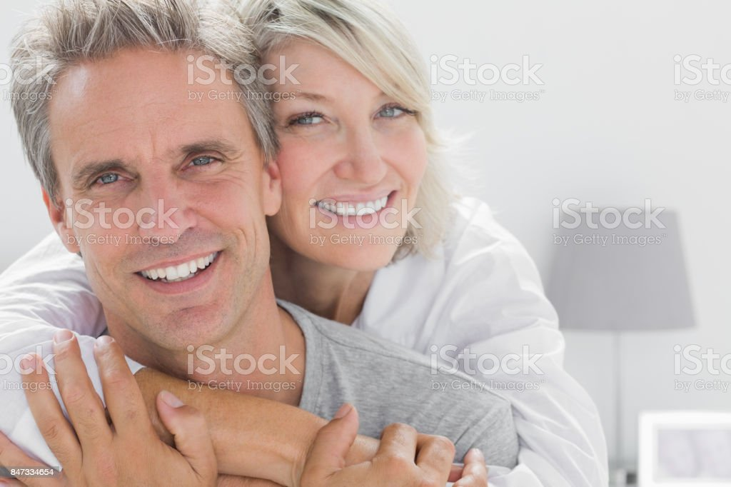 Affectionate couple smiling stock photo