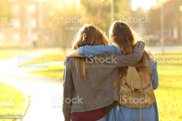Affectionate friends walking at sunset in a park picture id1127542683?b=1&k=6&m=1127542683&s=612x612&h=r5sotgs2hpday4oqminfgpt8v0hdgpjdxl6hcwtzjvc=