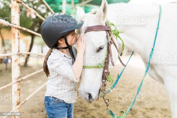 Affectionate girl kissing equine picture id1076814768?b=1&k=6&m=1076814768&s=612x612&h=zus9tceqjkshq oh00axhox et67 rd6q quedkiqgy=