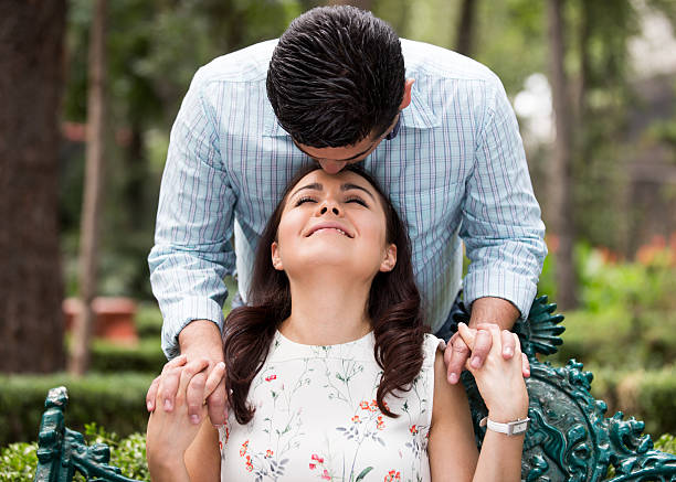Affectionate husband kissing wife on forehead - Photo