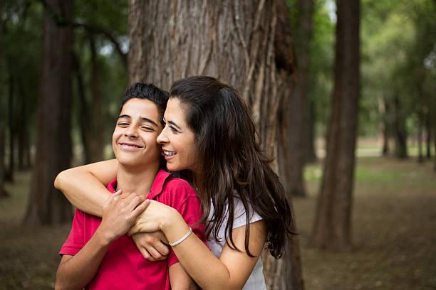 Affectionate latin mother embracing teen son and smiling picture id626491508?b=1&k=6&m=626491508&s=612x612&w=0&h=hh9pwzeboed1jix5kobglxpgwrzzvzp1oelrfxvl5js=
