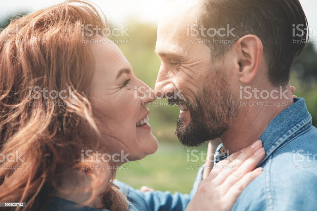 Affectionate man and woman embracing outdoor - Royalty-free Adult Stock Photo