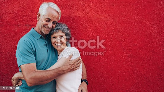 529076288 istock photo Affectionate mature couple embracing each other 522780318