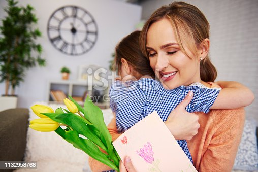 466231012istockphoto Affectionate mom and her daughter embracing at home 1132958766