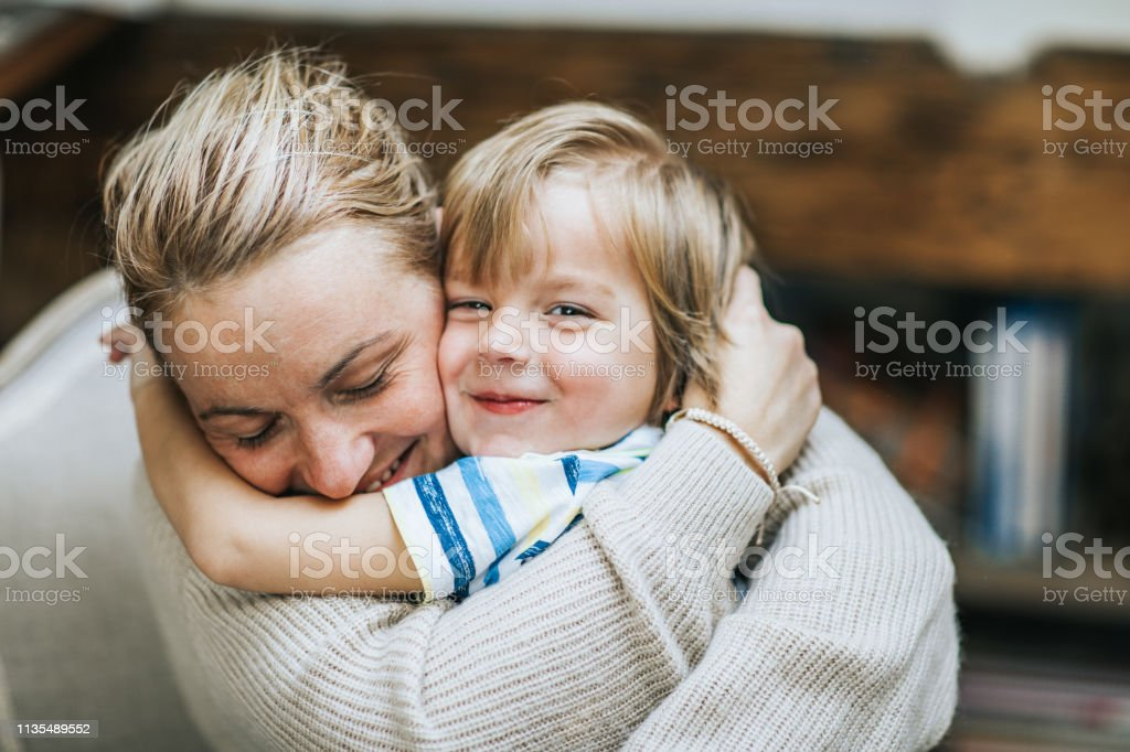 Affectionate mother and son embracing at home. - Стоковые фото Близко к роялти-фри