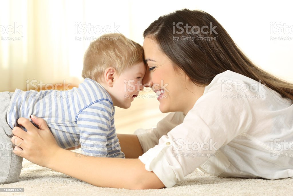 Affectionate mother with her baby stock photo