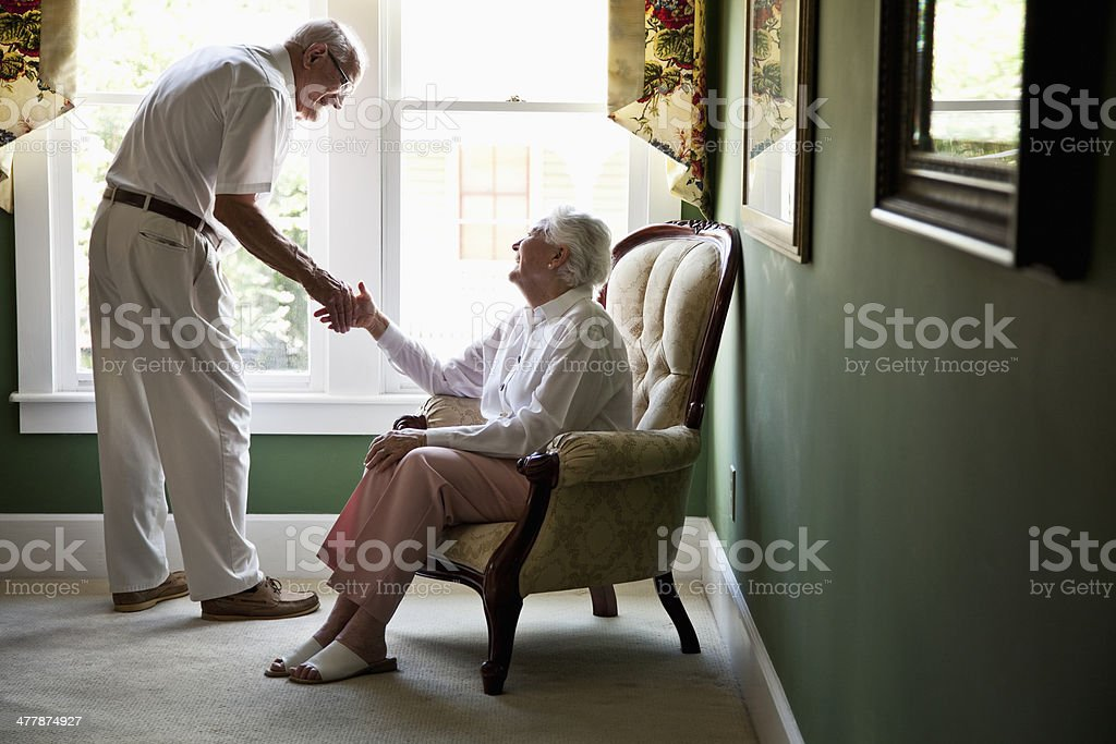 Affectionate senior couple at home stock photo